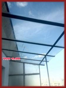 Стъклена козирка на тераса